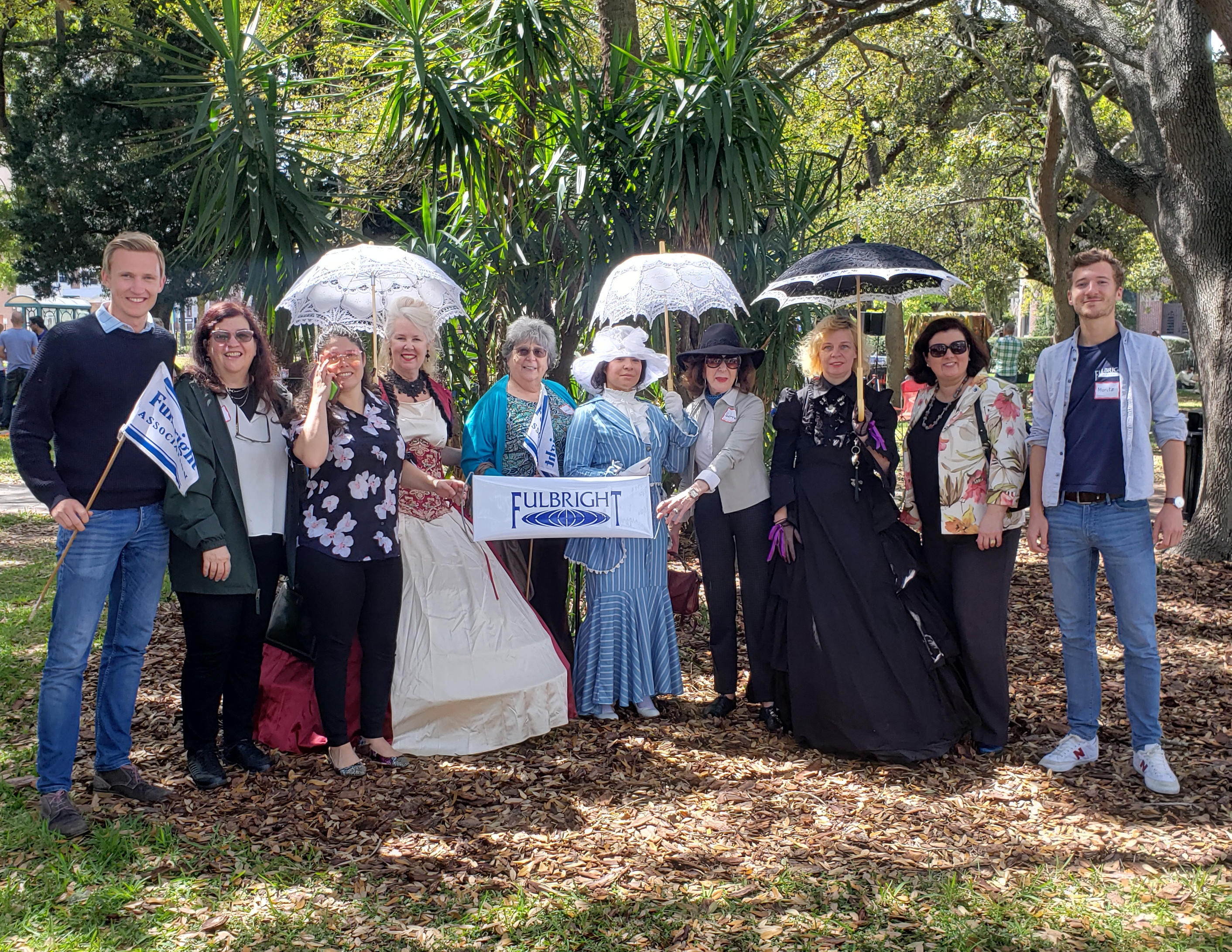 Participants pose with picnic-goers in costume